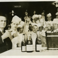 Oscar and kitchen staff celebrating the end of Prohibition